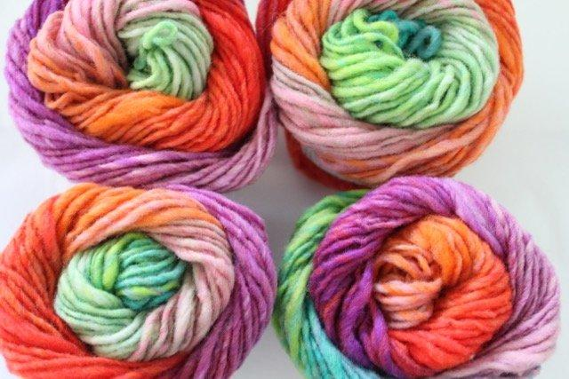 Noro Kureyon - 319 9 purples, reds, orange, lime)